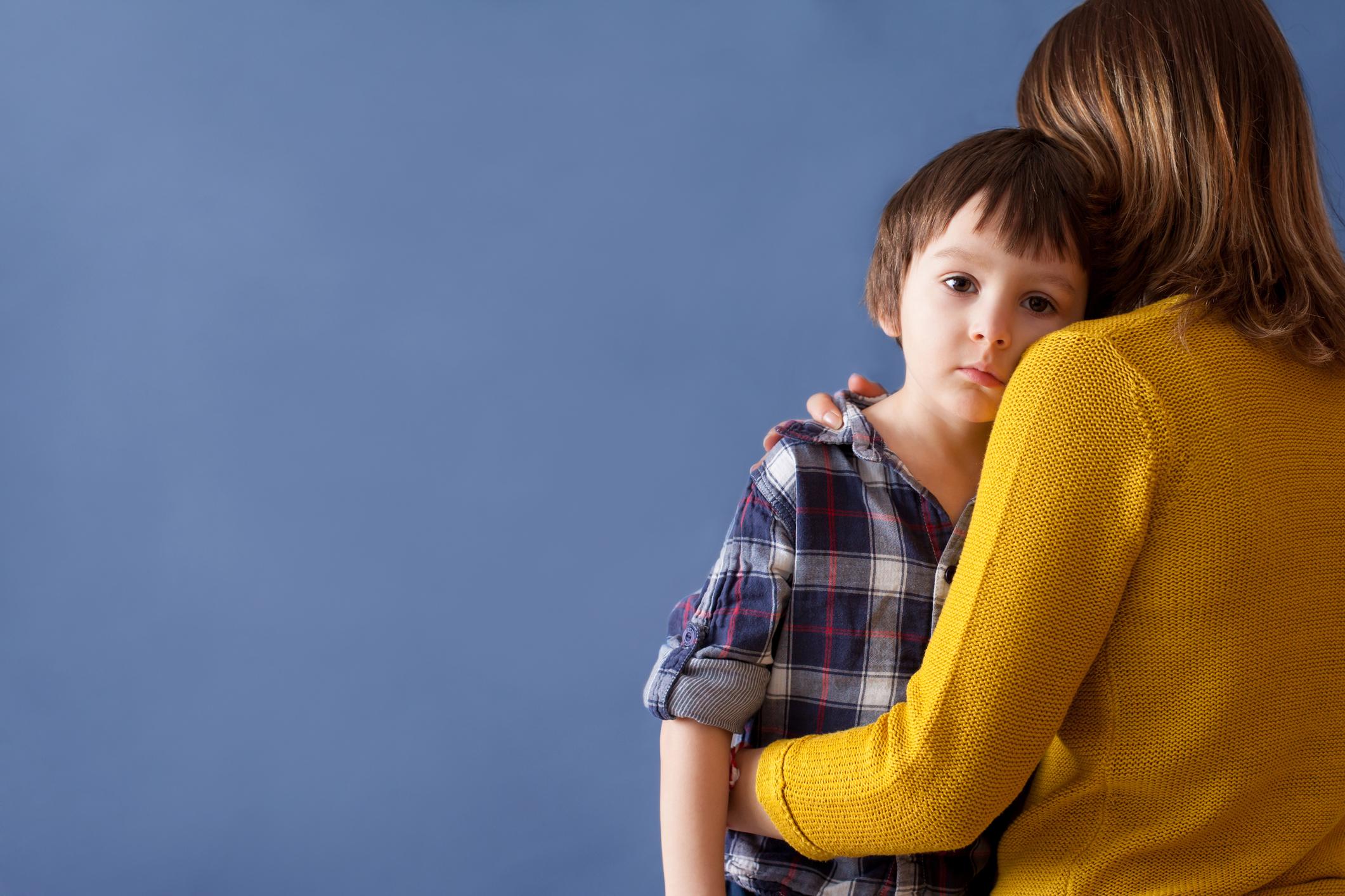 Sad Boy being hugged.jpg