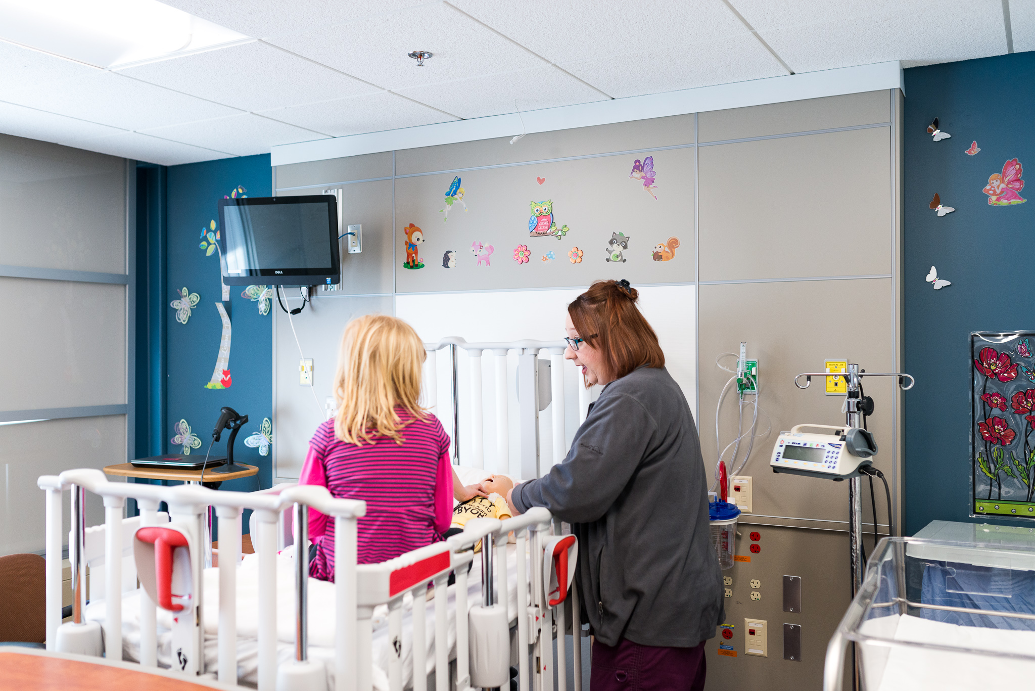 Child life specialist Jennifer talks to patient and develops a relationship