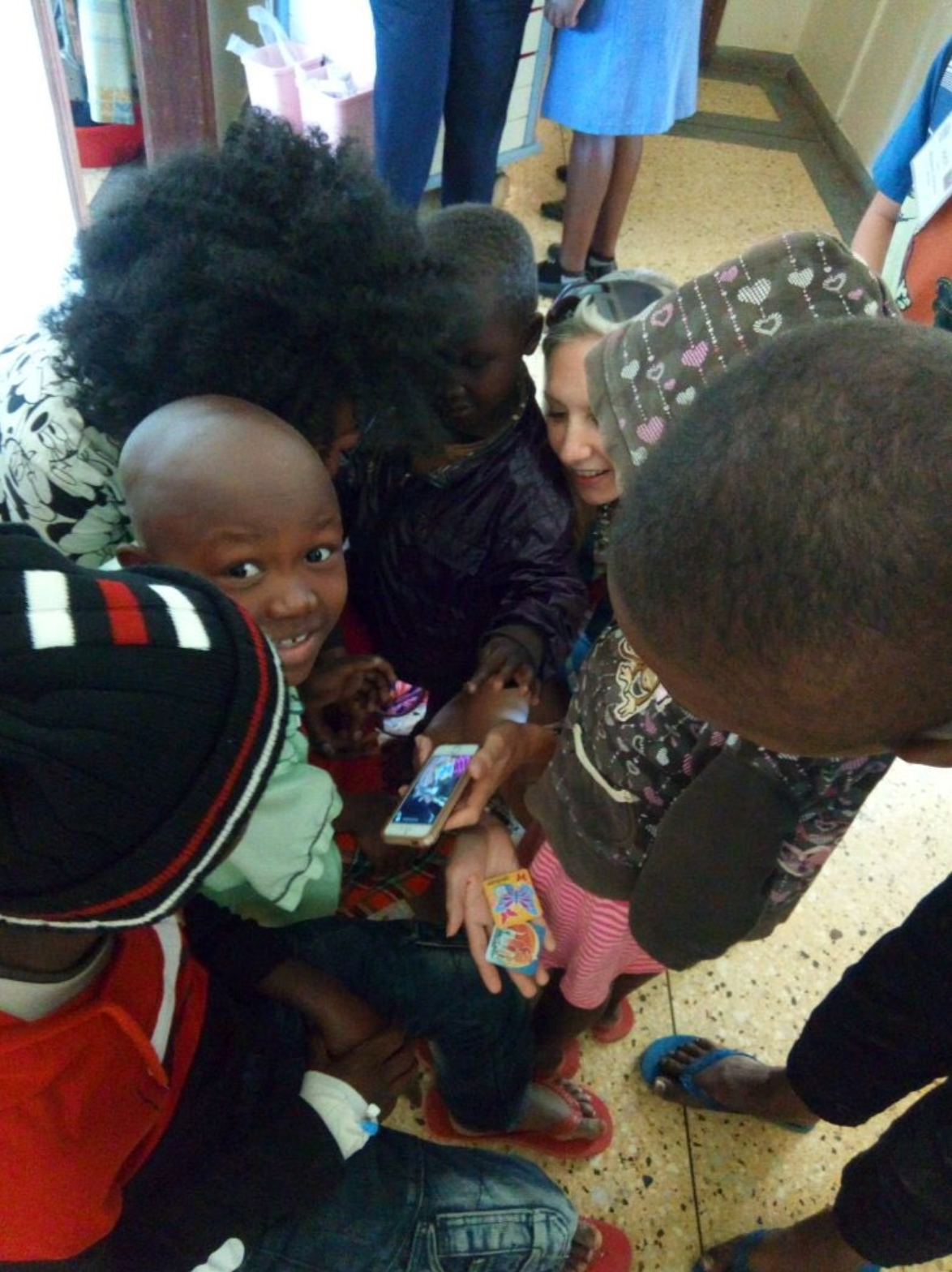 Morgan introducing SpellBound to the patients in Kenya. Photo provided by Morgan Livingstone.