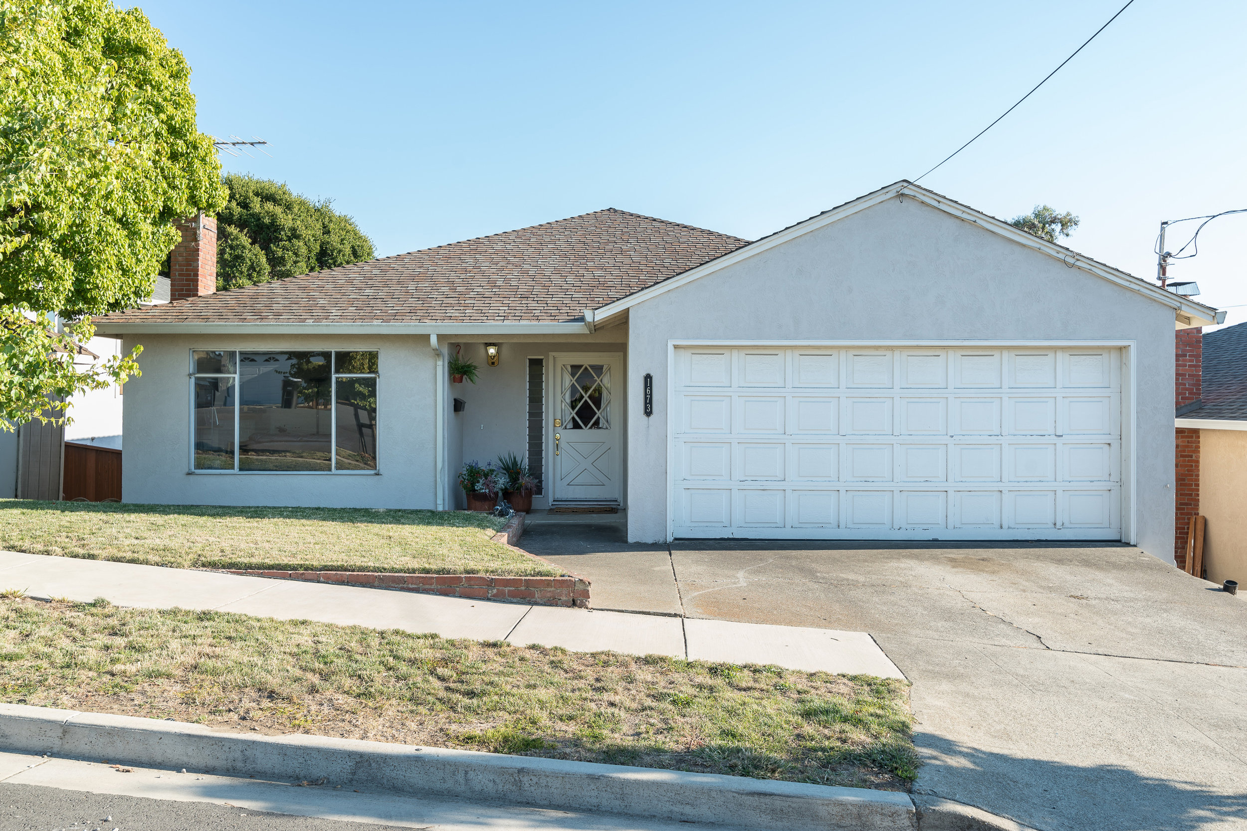 A great home in Hayward hills, near Cal State East Bay. Home features 3 bedrooms, 2 bathrooms, 2 car garage, and 1,944 square feet of living space, 7,000 square foot lot, built in 1959. It has a great open remodeled kitchen, with Shaker style  cabinets, recessed lighting, hard wood flooring, granite  counters, stainless steel appliances, Viking Stove and a large butcher block island, with sink. Lots of storage in kitchen and throughout the home. Master bedroom has a large walk in closet and bathroom. Downstairs has a large bedroom and rumpus room, plus potential wine cellar. Large open backyard with view of open space and trees.