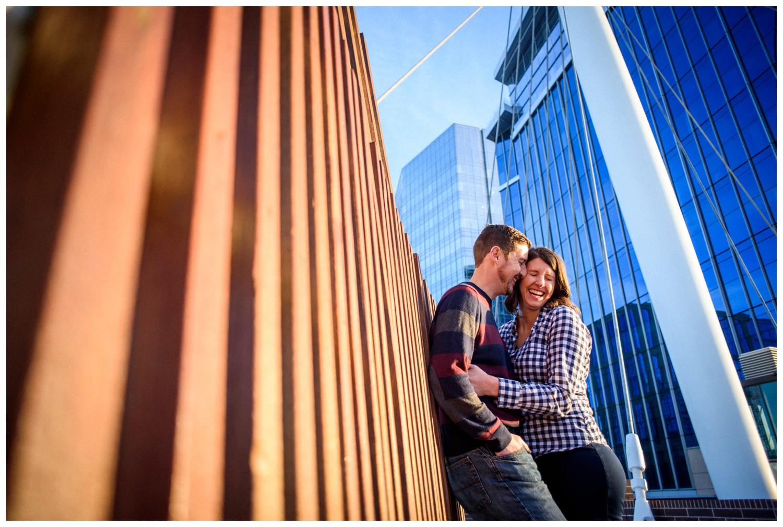 engaged couple laughs on Millenium Bridge
