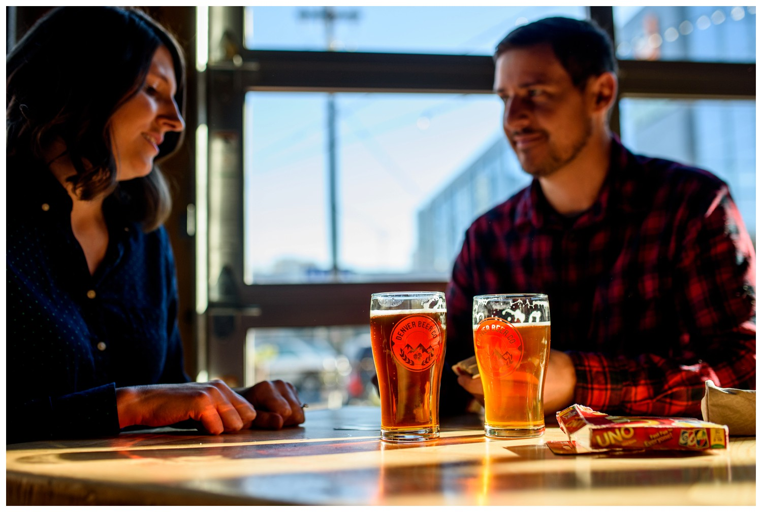 couple plays Uno at Denver Brewery