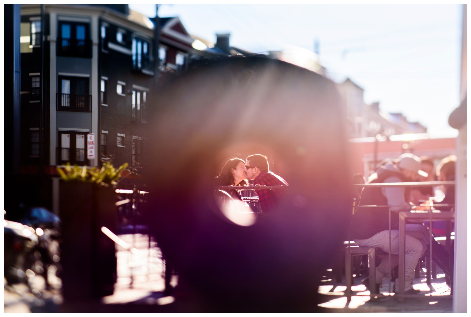 creative photo of couple kissing with rainbow colors