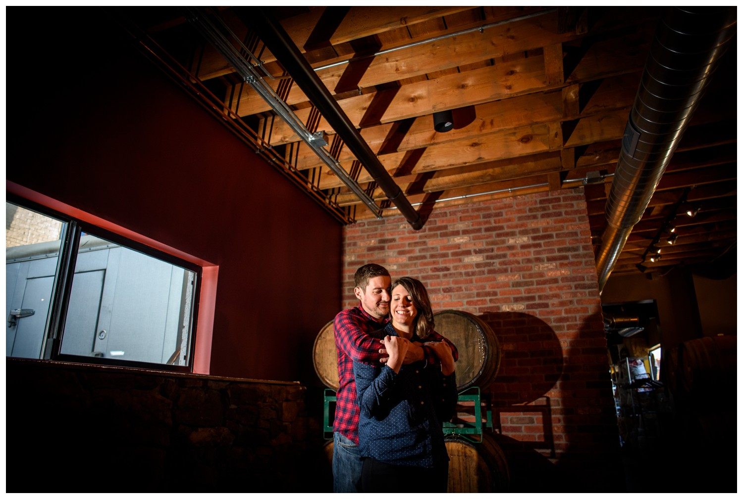 engagement photo with wooden beer barrels
