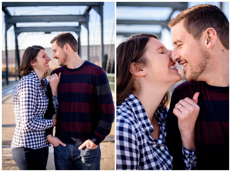 couple kiss on downtown Denver Bridge