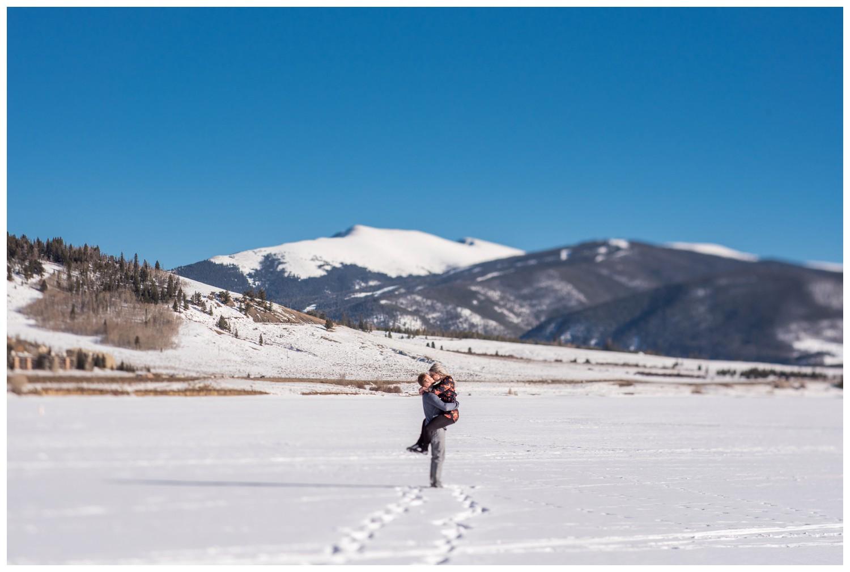 guy lifts girl on colorado mountain lake