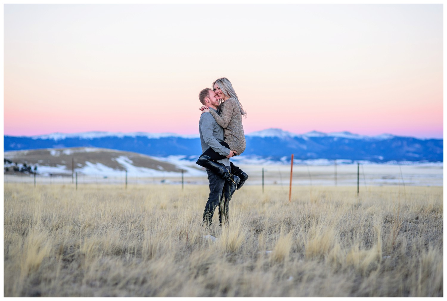engagement photo with colorful colorado sunset