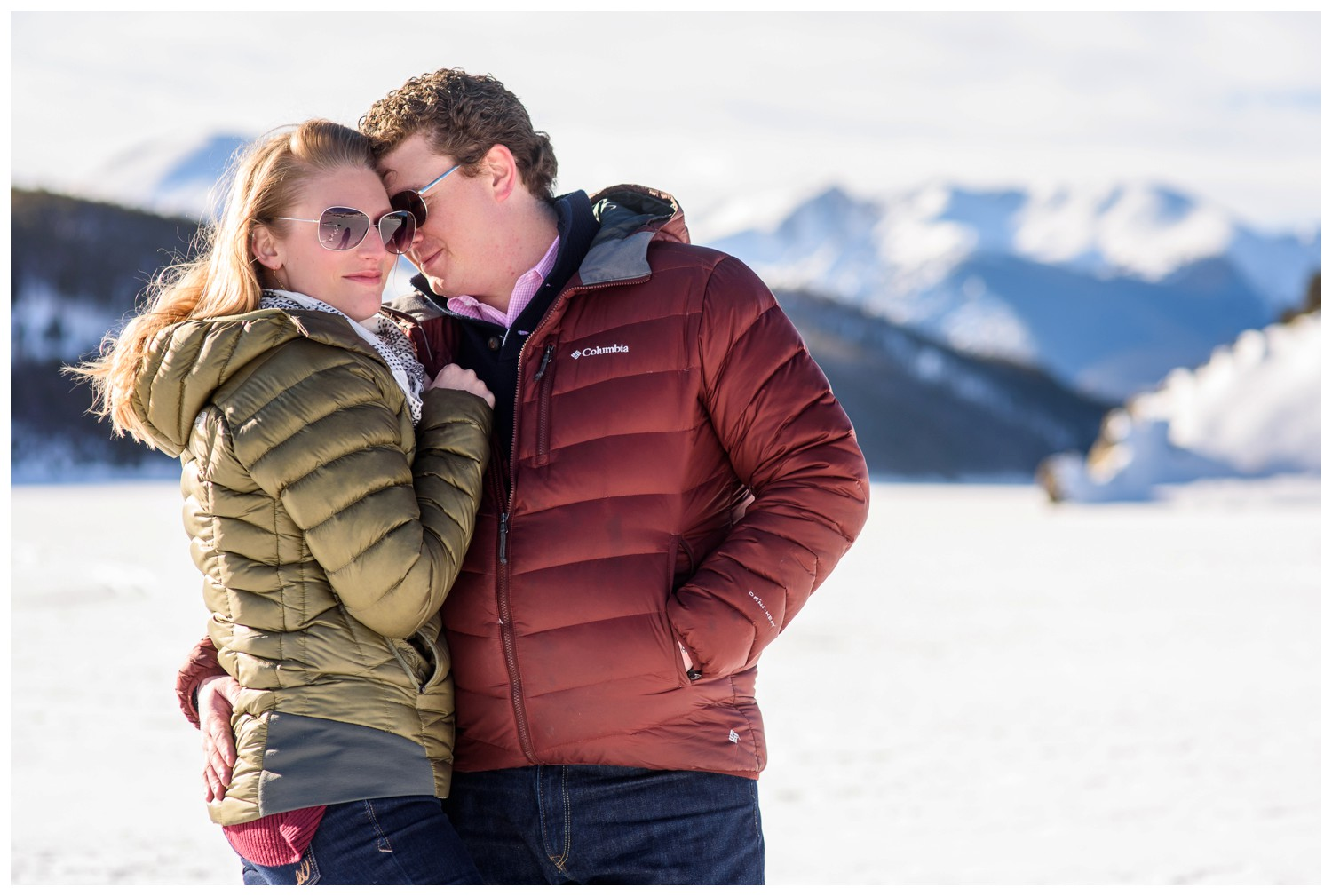 couple in puffy jackets on Winter lake