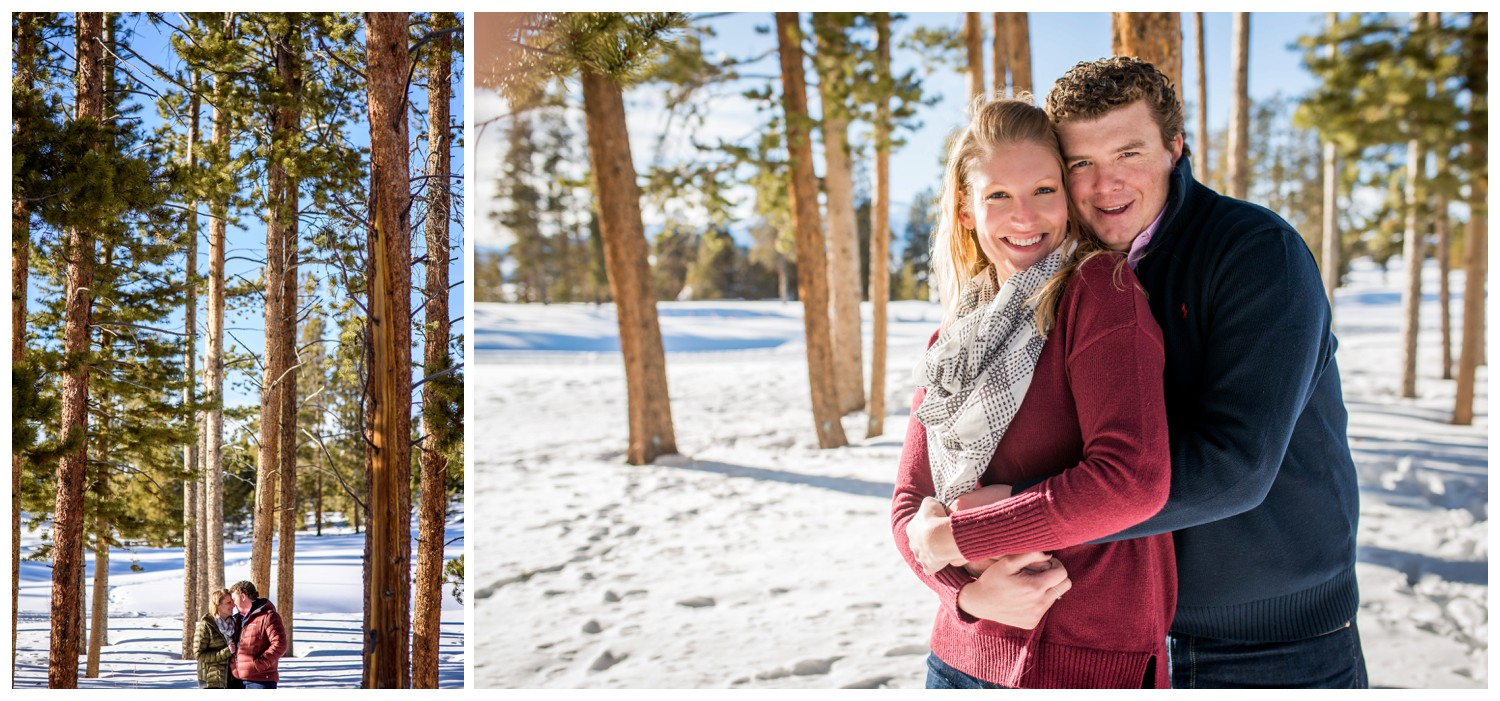 laughing couple in sunny colorado pine forest as snow falls