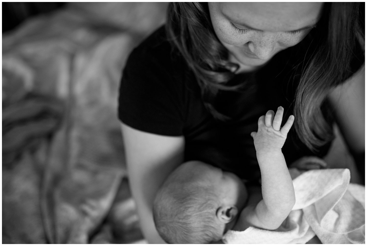 lifestyle newborn photography of baby hand and mother