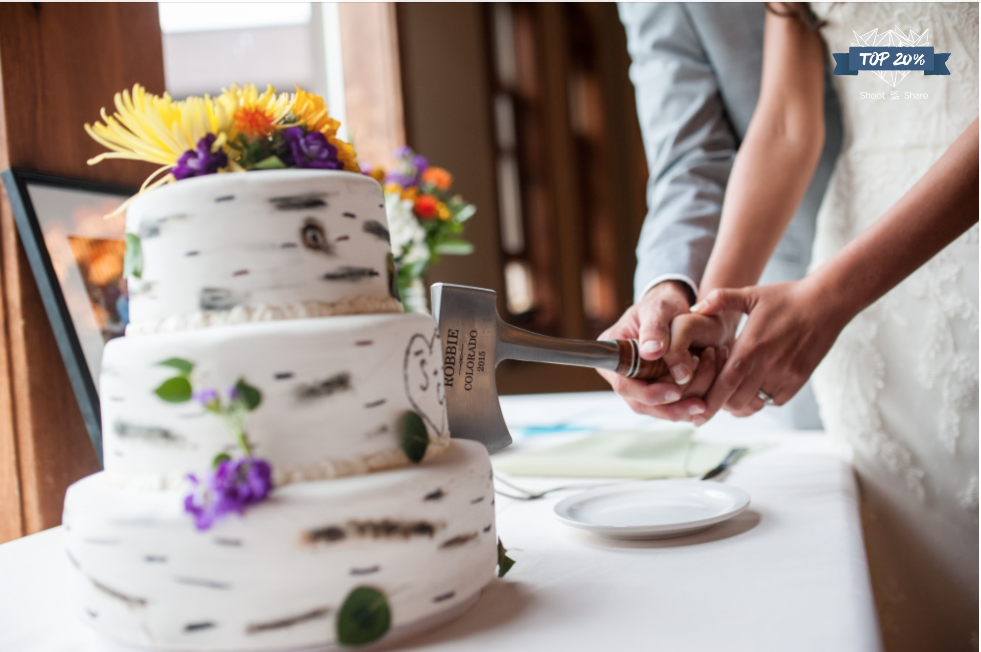 Cutting the Wedding cake with flair; Granby Ranch, Colorado