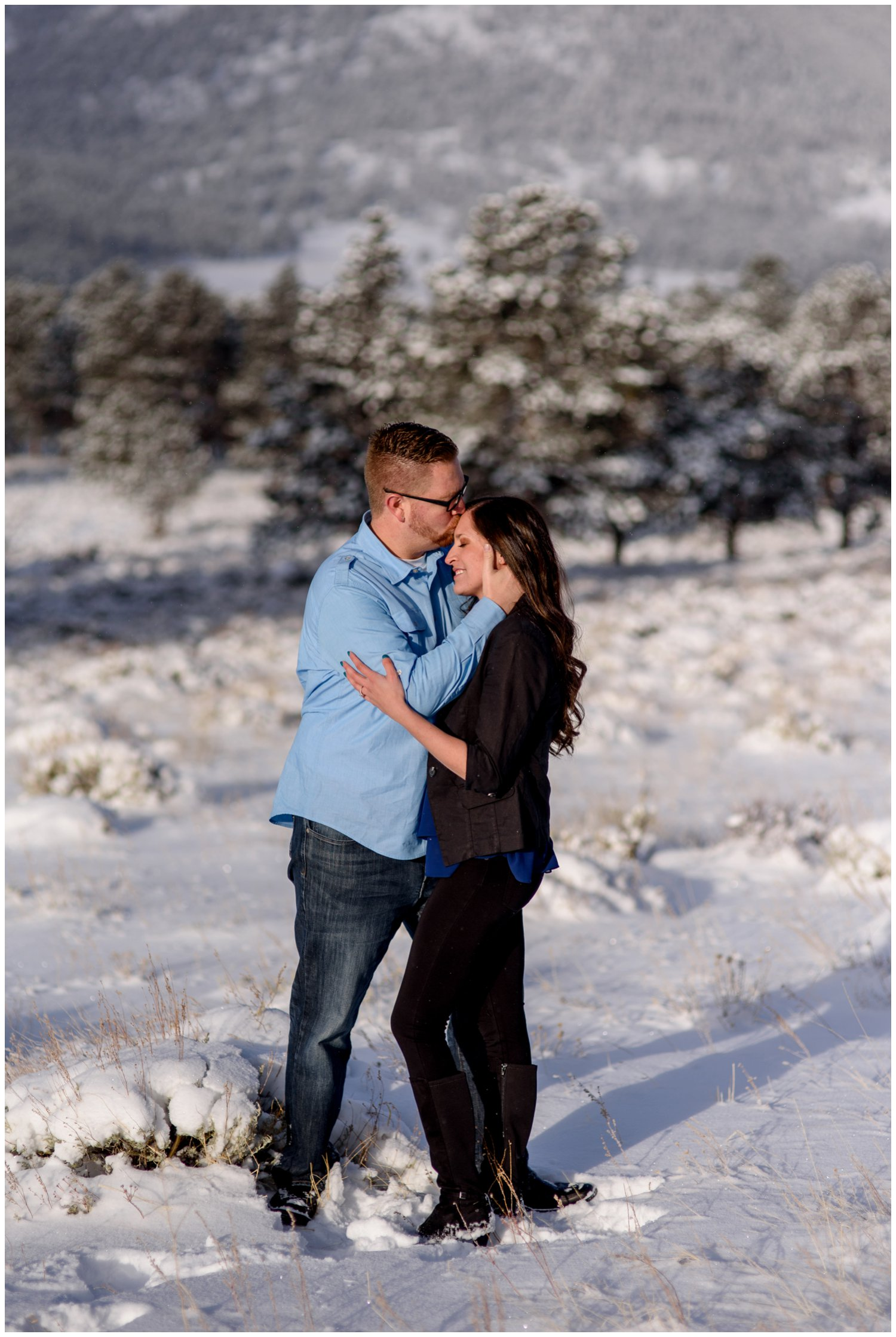 couple hugs in Estes Park snowy mountain photo
