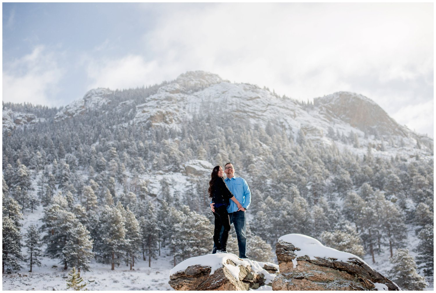Epic engagement photo on top of rock in Rocky Mountains