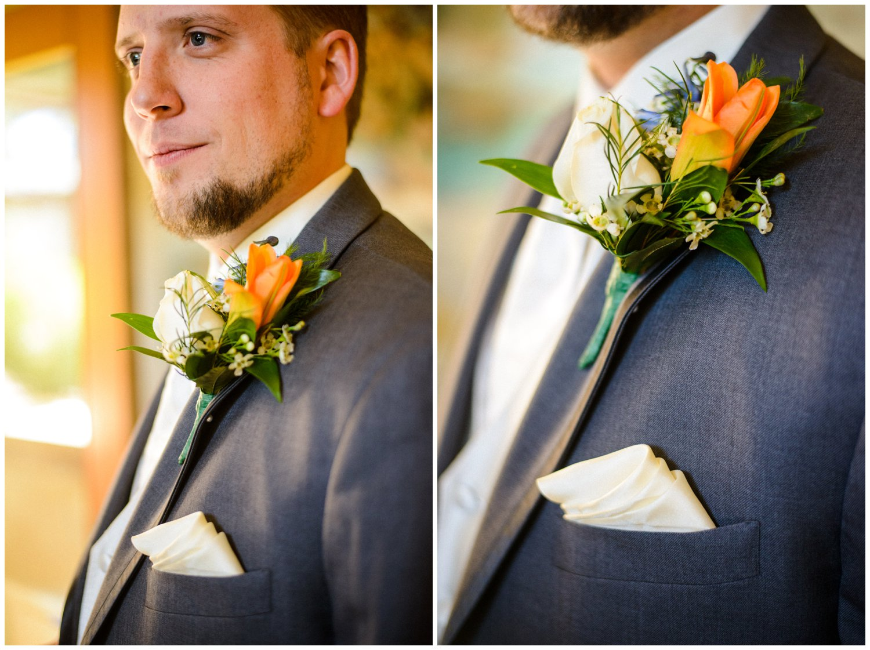 Orange Boutonniere on groom gray suit