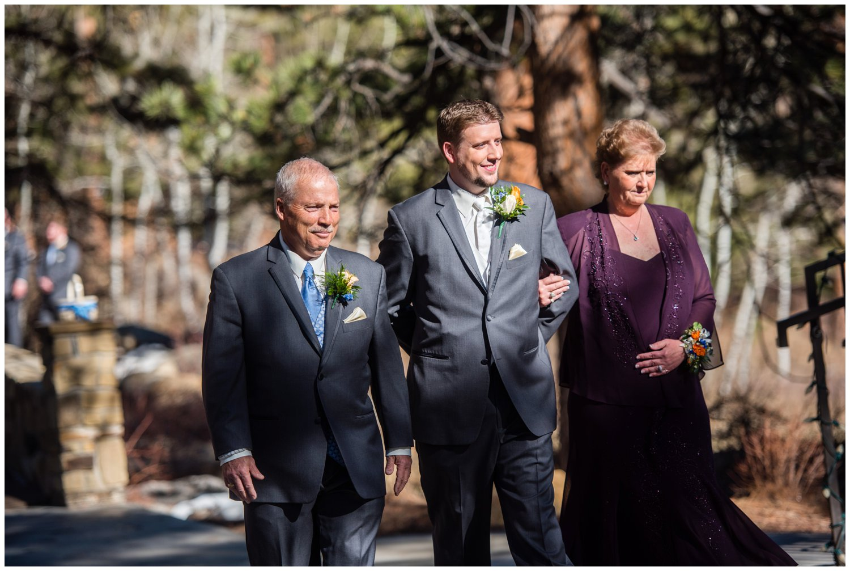 Groom at wedding ceremony in Estes Park