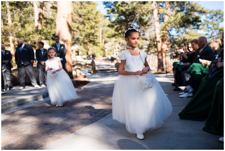 cute flower girls walk into ceremony in Colorado