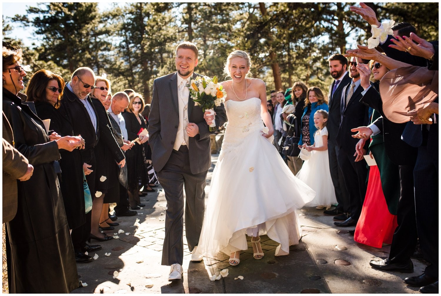 Bride and groom exit sunny mountain ceremony