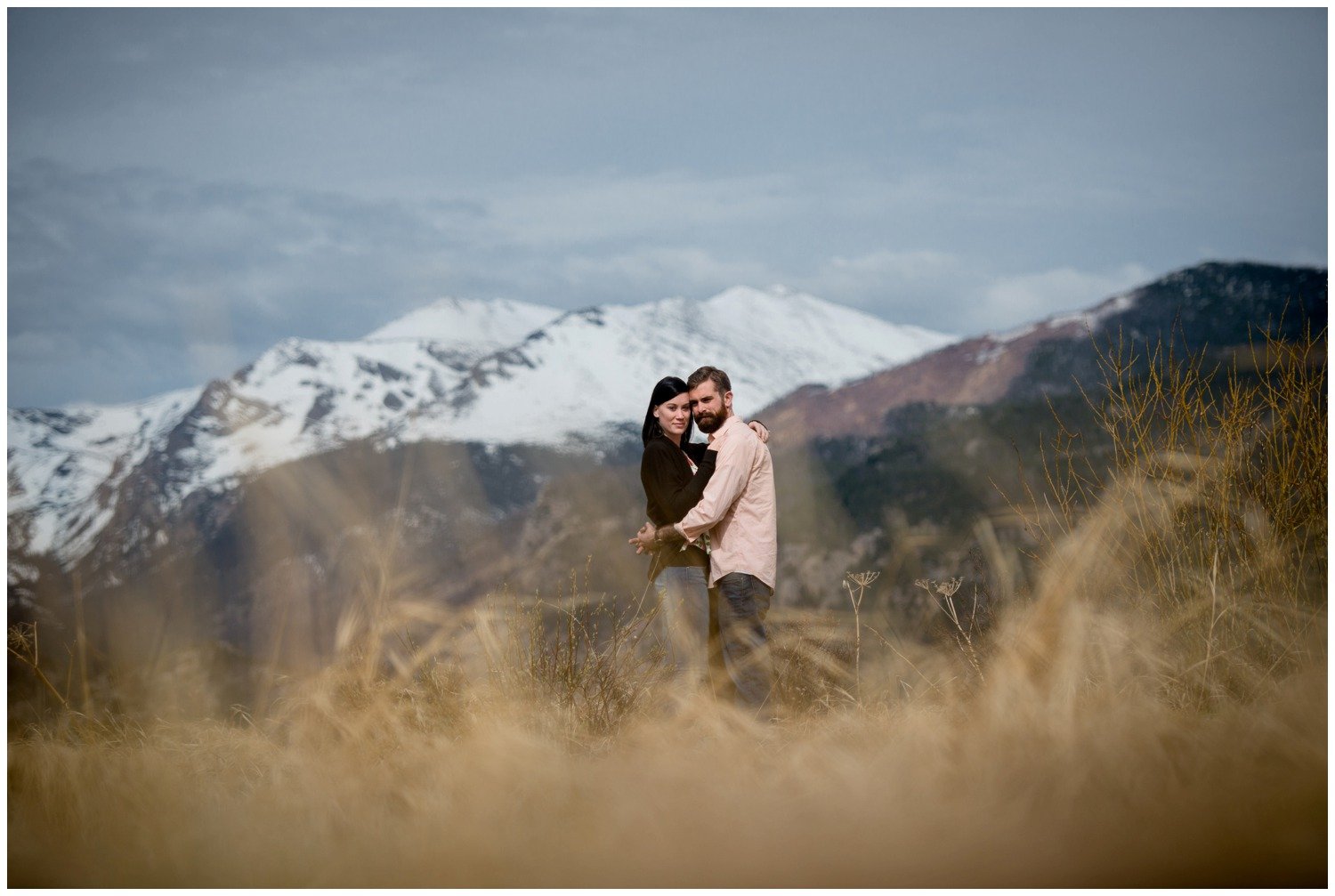 Colorado mountain engagement photo in tall grass