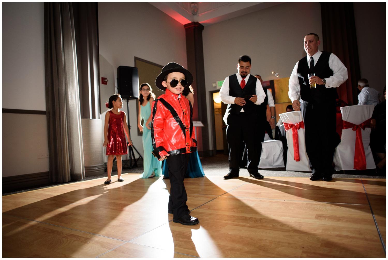 kid dressed as Michael Jackson at Wedding