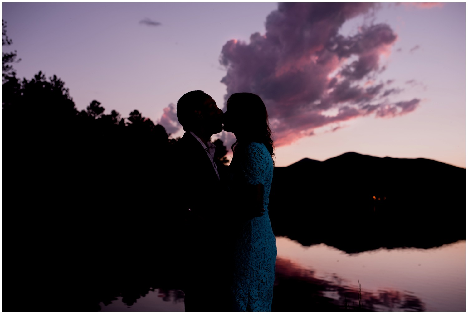 purple sunset engagement photo on lake