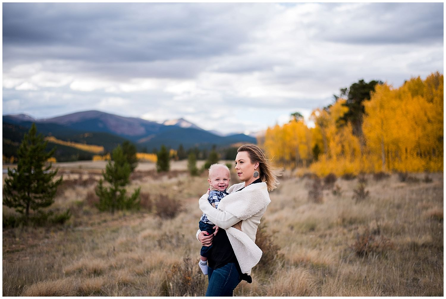 photo of mom with baby in Colorado Fall mountains