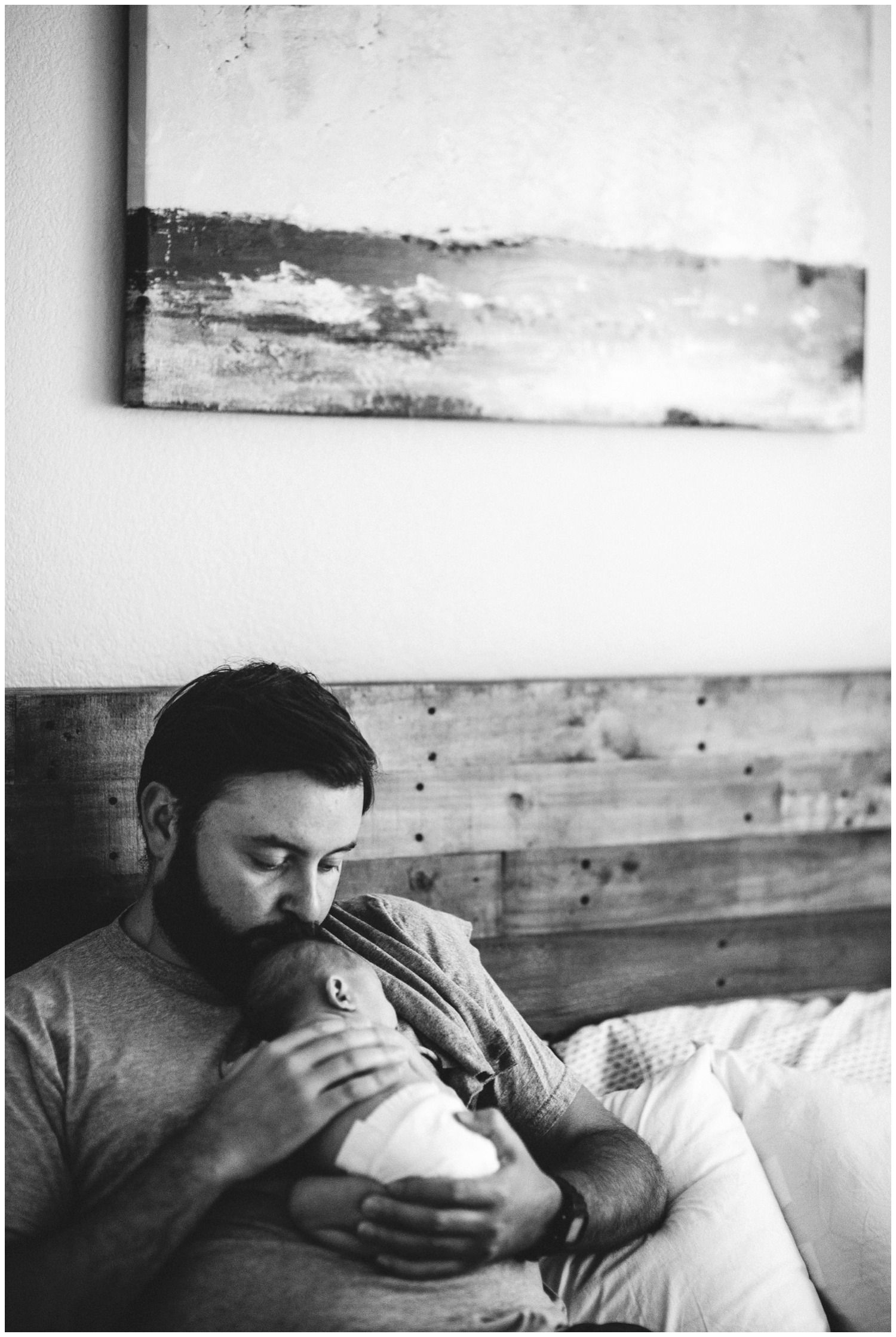 documentary photo of dad with newborn