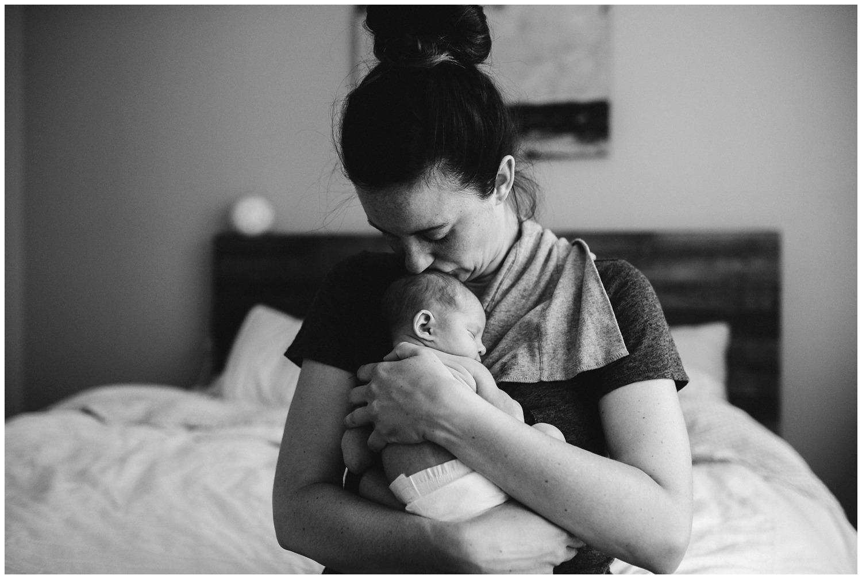 lifestyle newborn photo of mom and baby