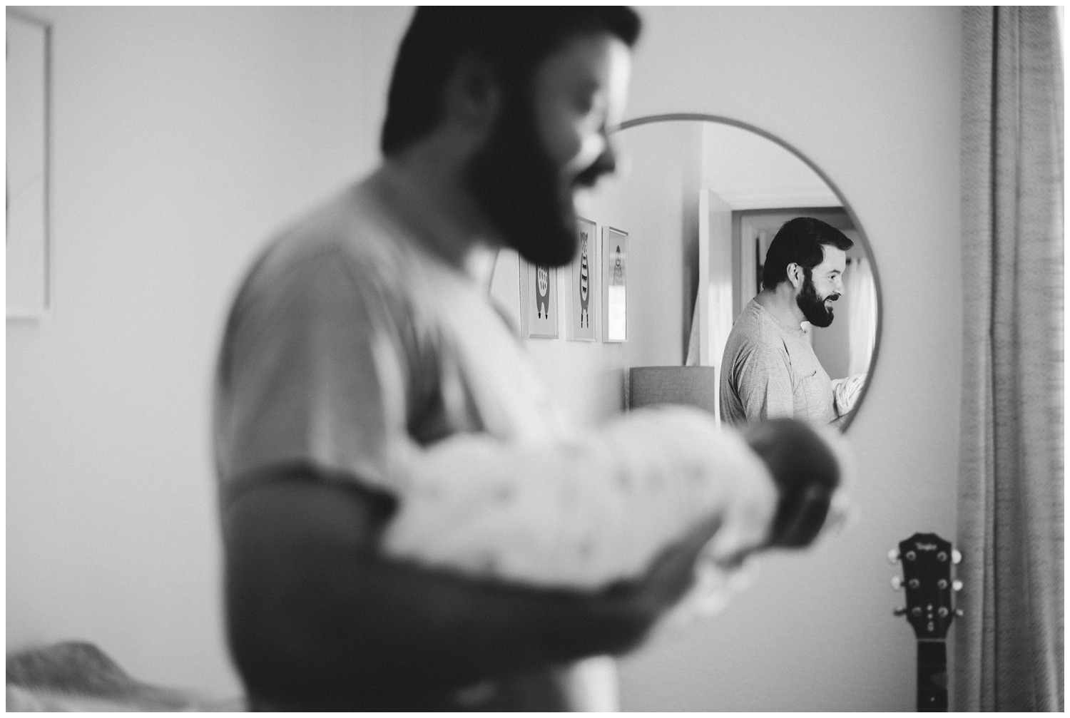 reflection photo dad with newborn