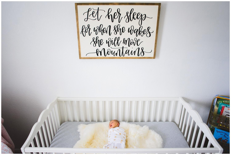 Newborn photo in crib
