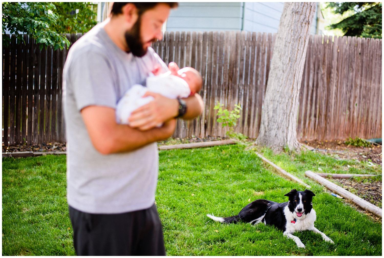 dog and newborn photo outside