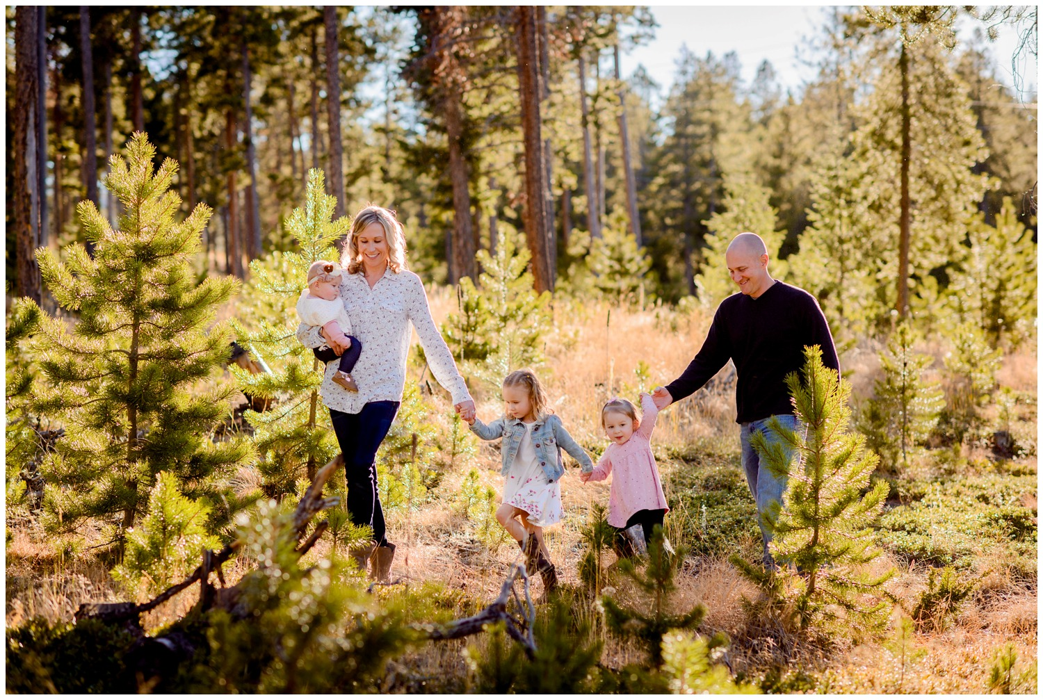 candid Colorado family photo in mountains