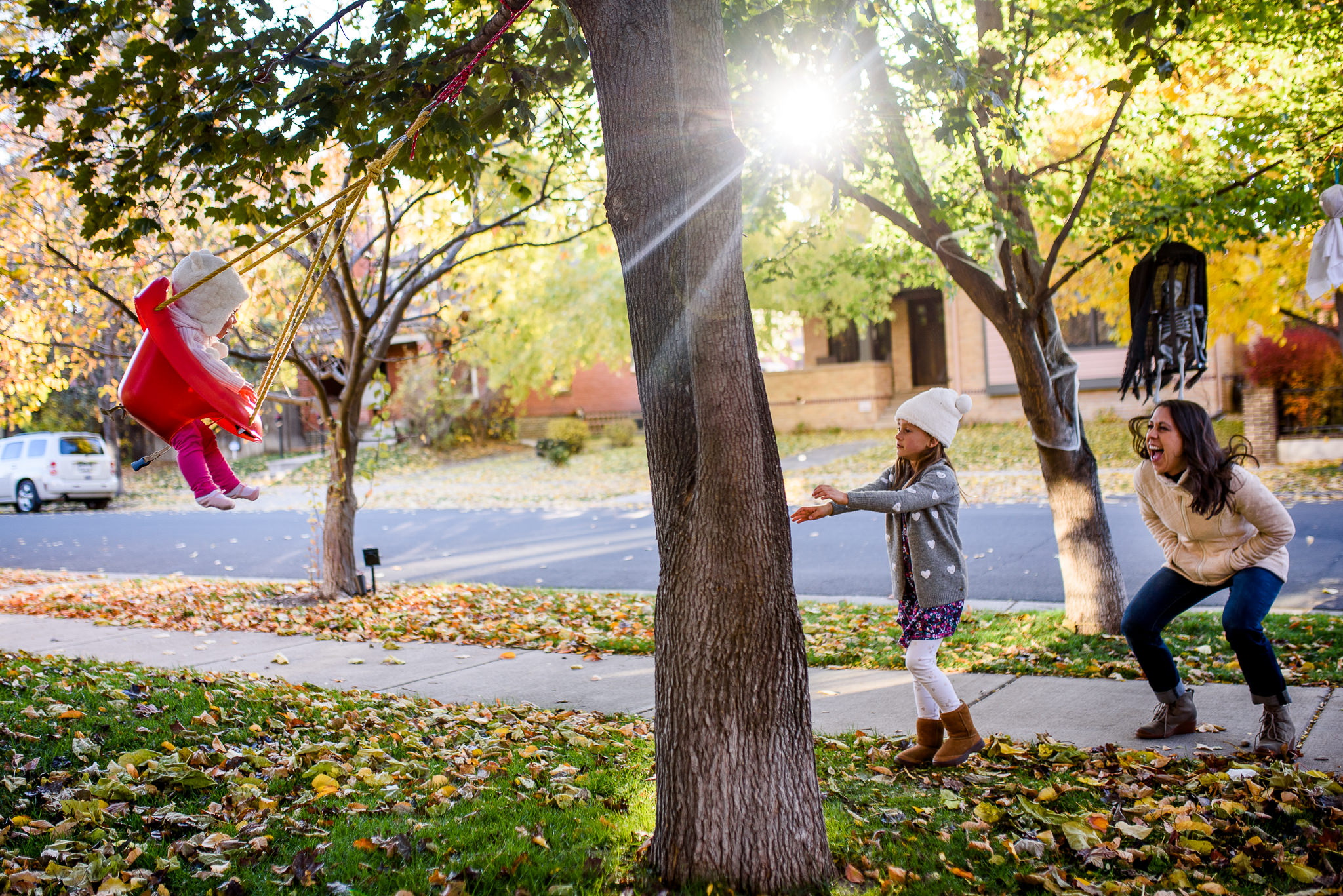family playing in yard in Denver in Fall