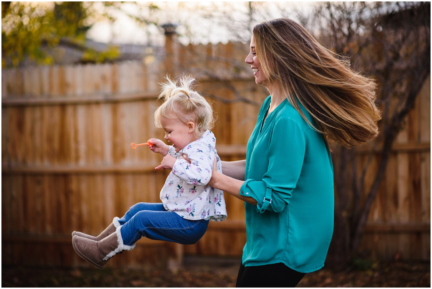 mom and daughter twirl in colorado family photo