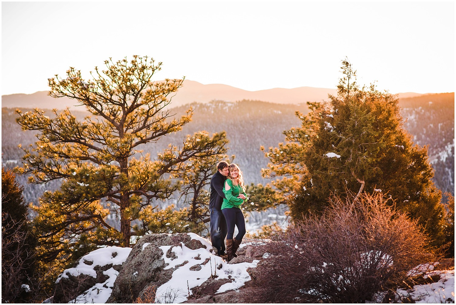 Engaged couple posing for a photo on top Mt. Falcon in Evergreen Colorado