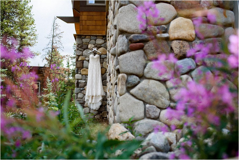 wedding dress hangs in colorado wildflowers