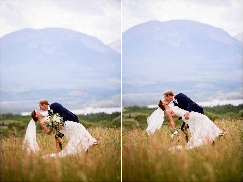 Groom dips bride in Colorado mountains near Keystone