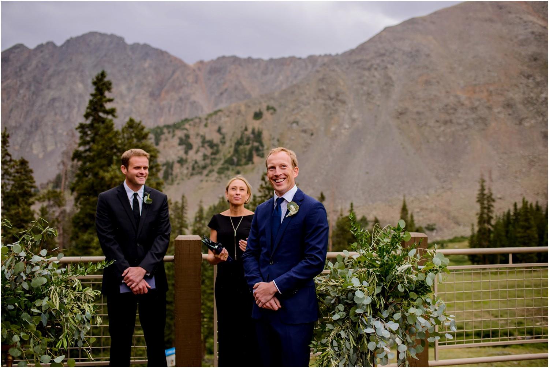 Groom waits for bride at Arapahoe Basin mountain