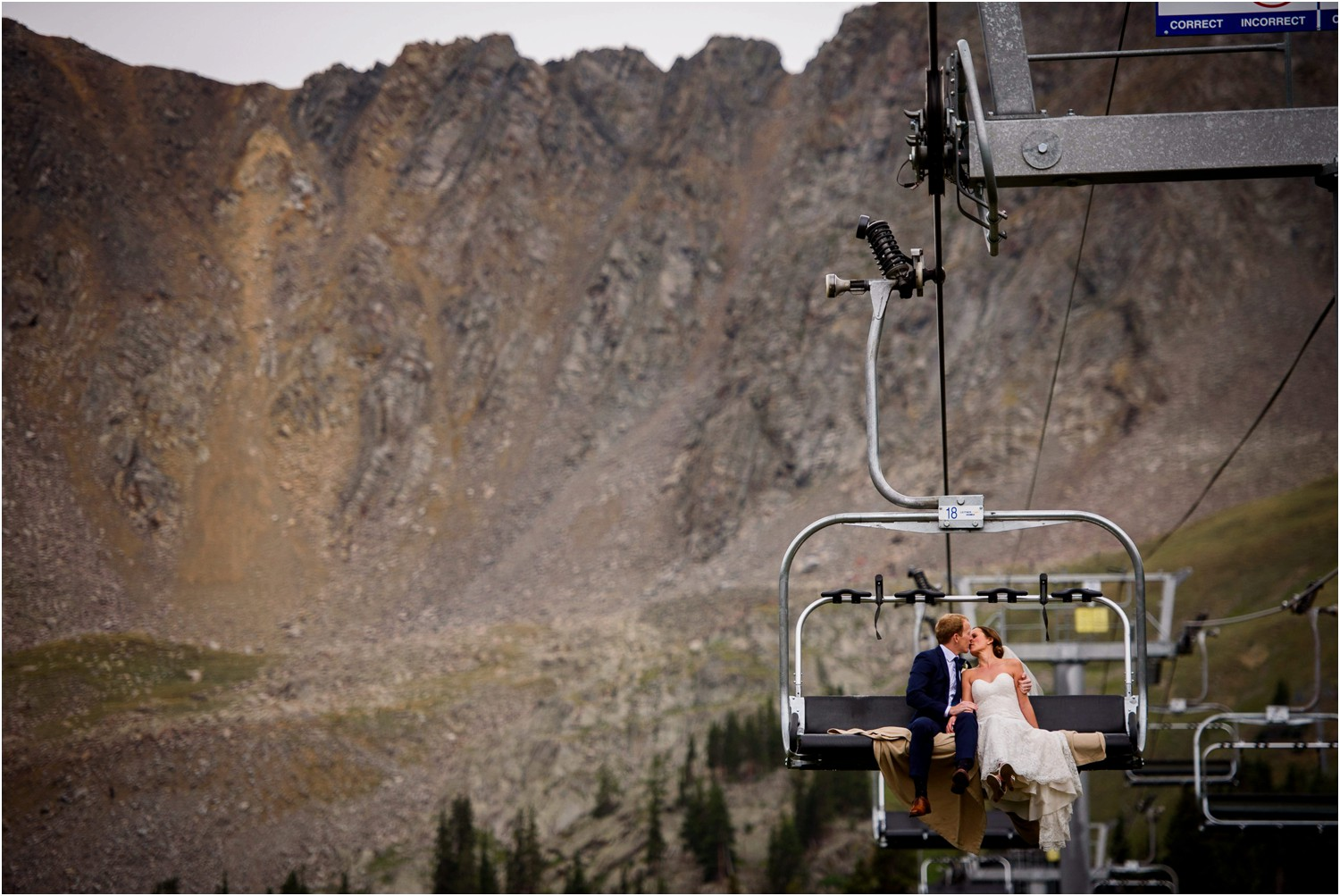 Bride and Groom kiss on ski Chairlift at Arapahoe Basin Colorado