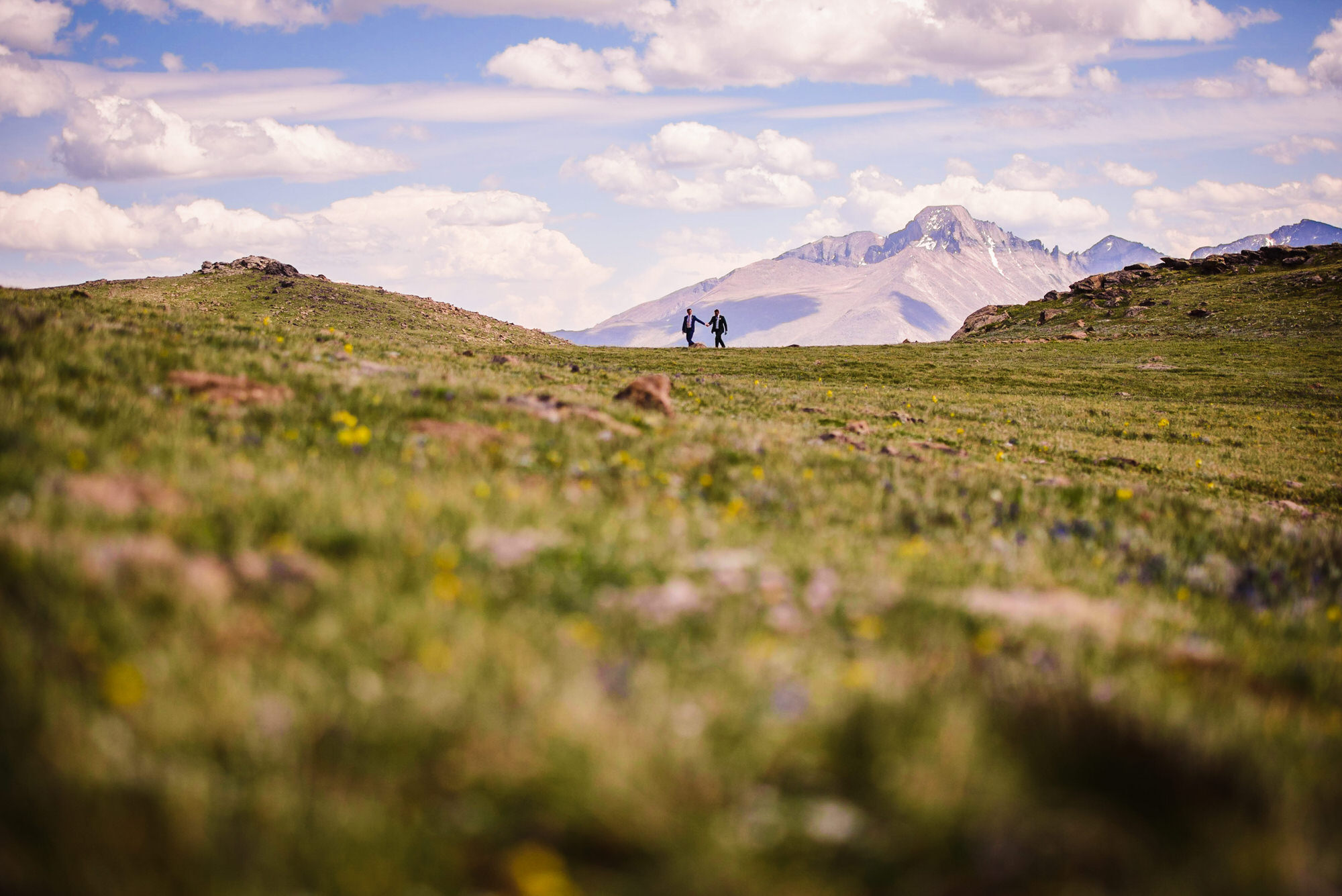 Estes Park LGBTQ wedding with two grooms Longs Peak in background
