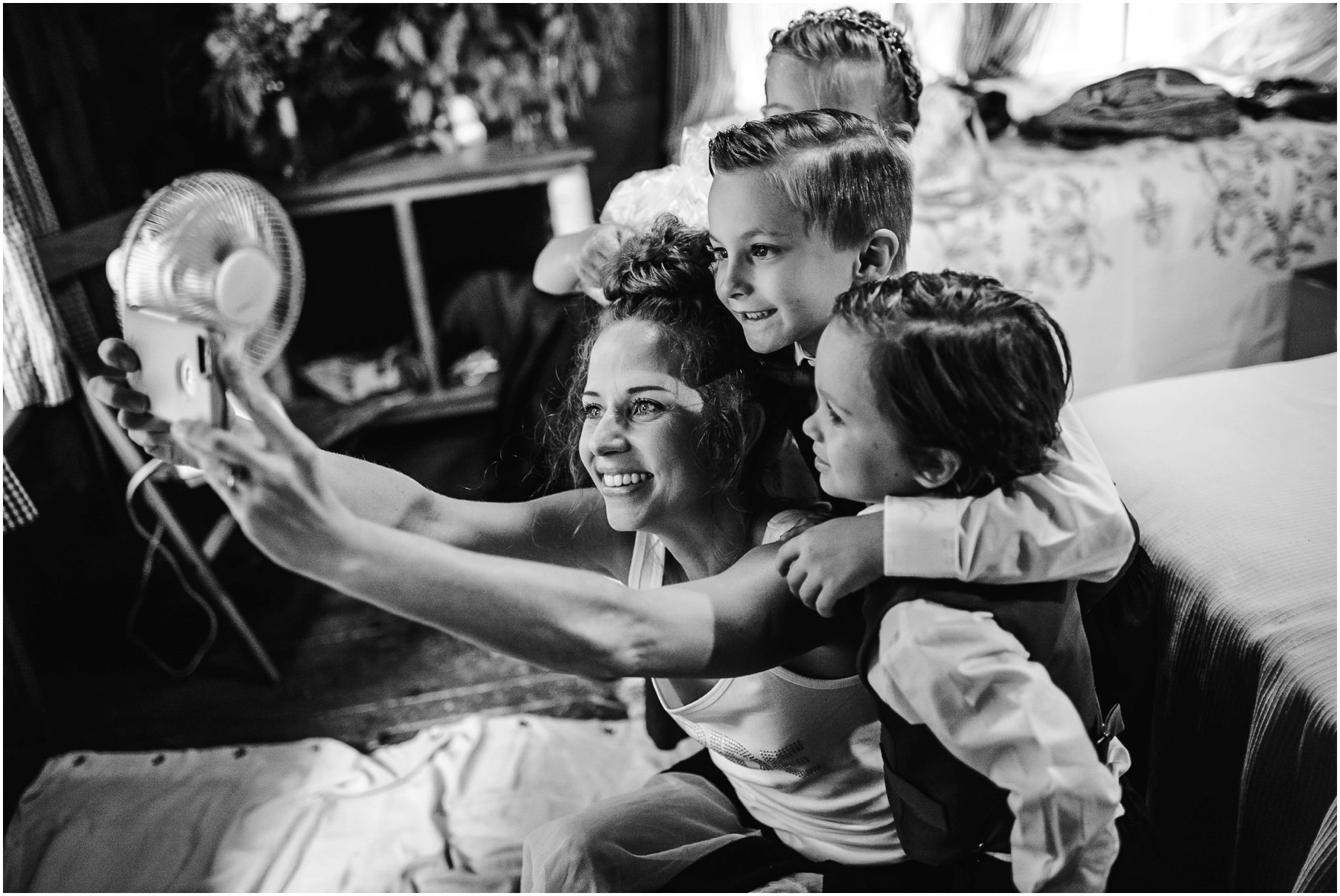 candid wedding moment of bride with kids