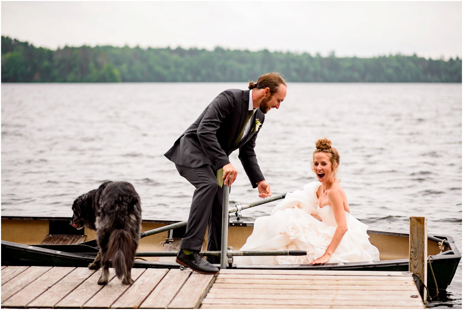 candid image of bride and Groom getting into boat on lake