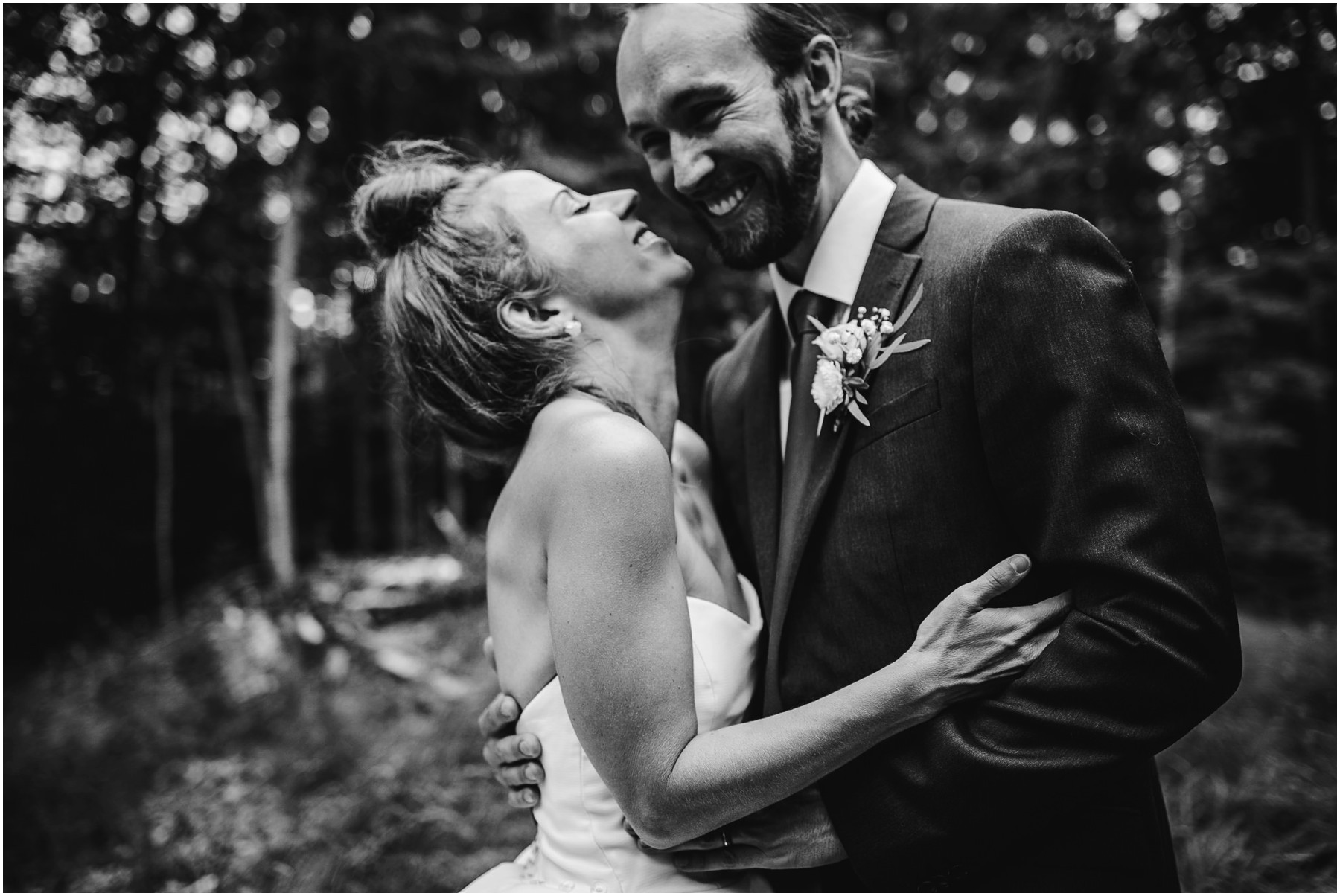 candid black and white wedding photograph