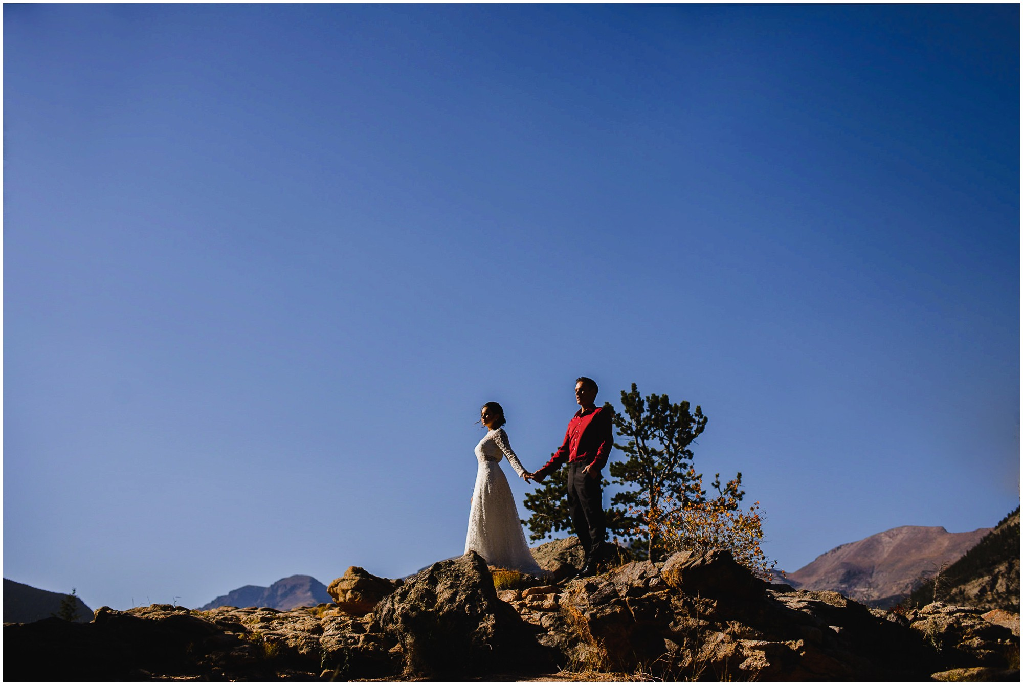 Rocky Mountain National Park wedding photo of Bride and Groom on high rock