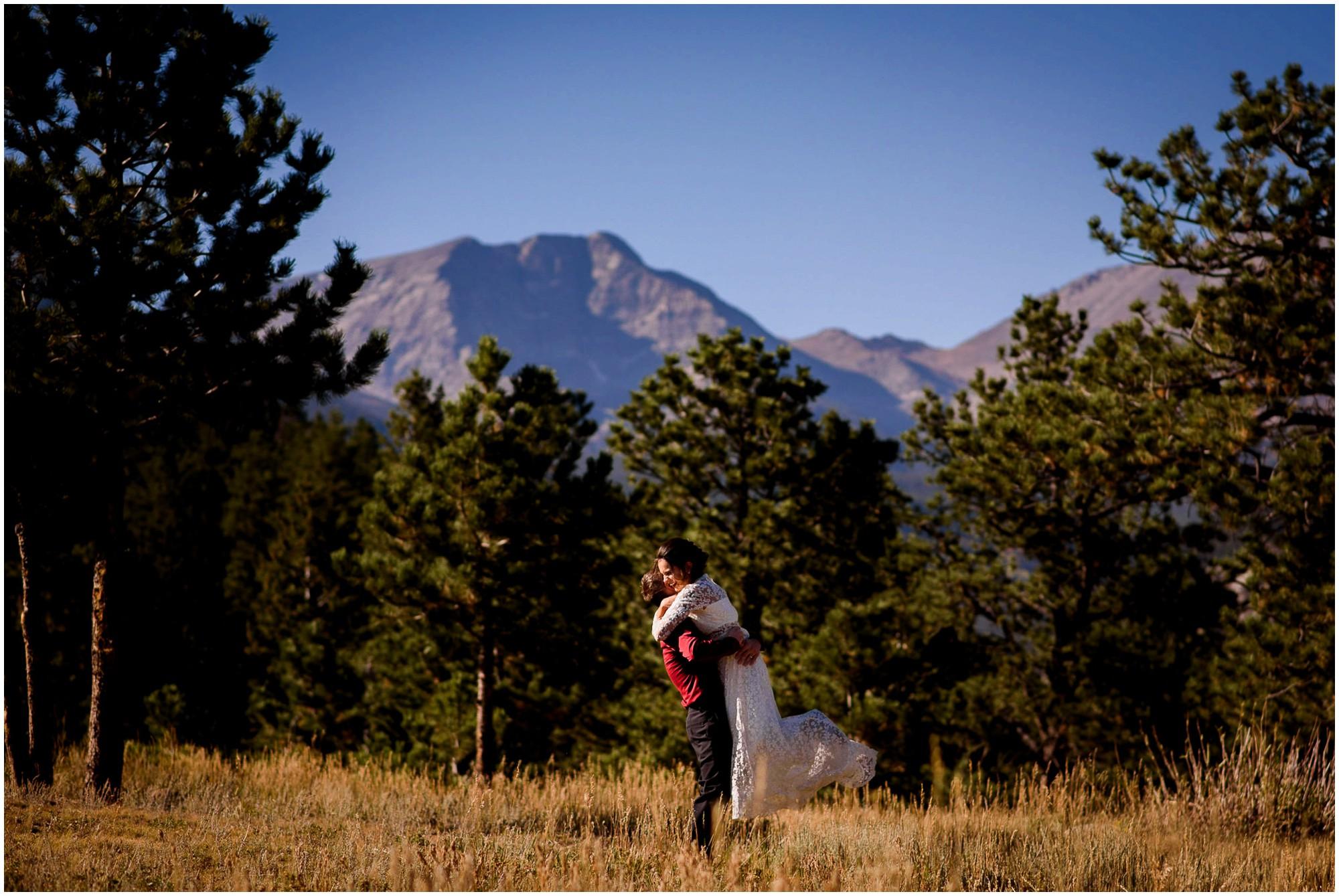 Bride and Groom hug in Colorado Mountain Meadow at Deer Junction