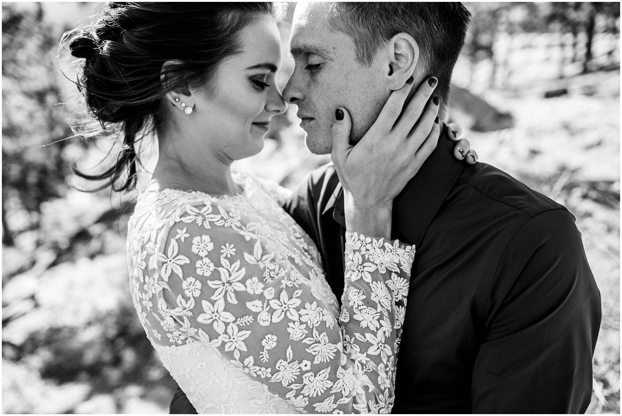 intimate black and white portrait of bride and groom