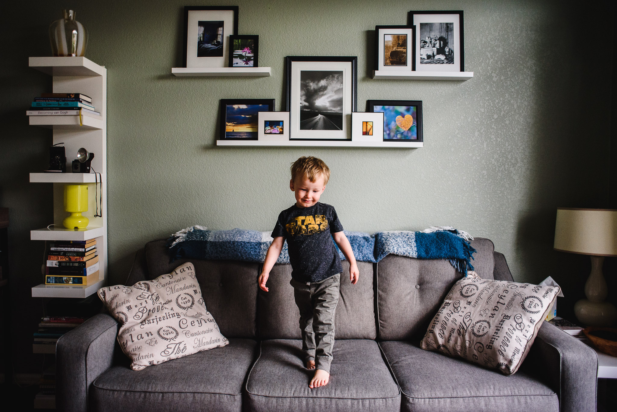 Kid jumps on couch during candid family photos
