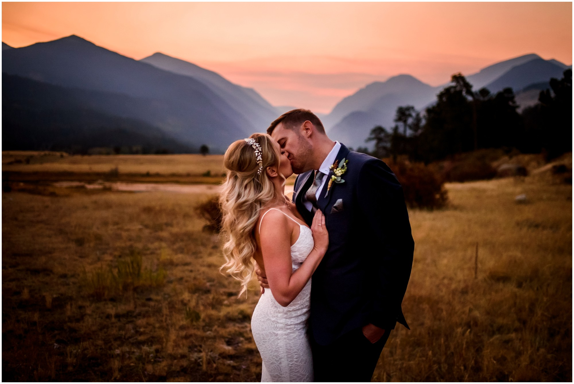 Bride and groom kiss at Sunset in Rocky Mountain National Park elopement