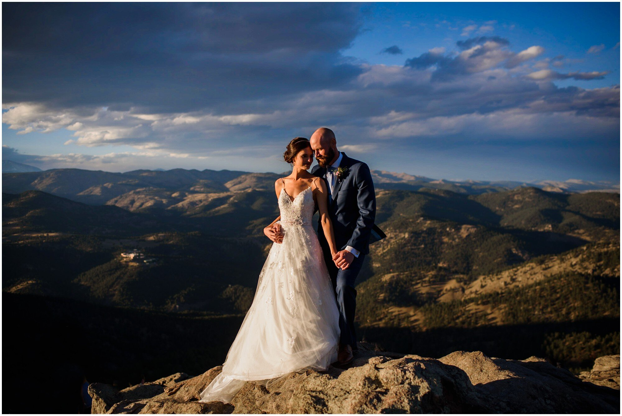 Stunning bride and groom on the top of a mountain in Boulder Colorado