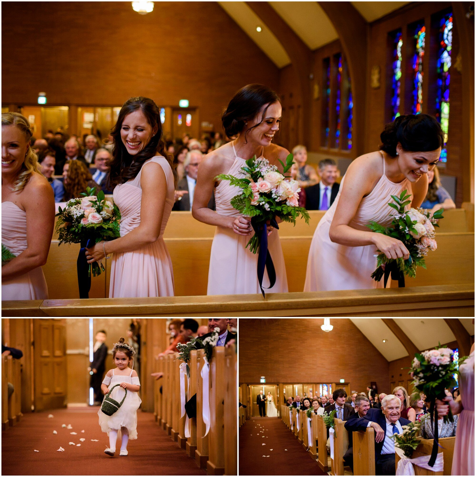Bridesmaids smile at cute flower girl in flower crown walking down the aisle.