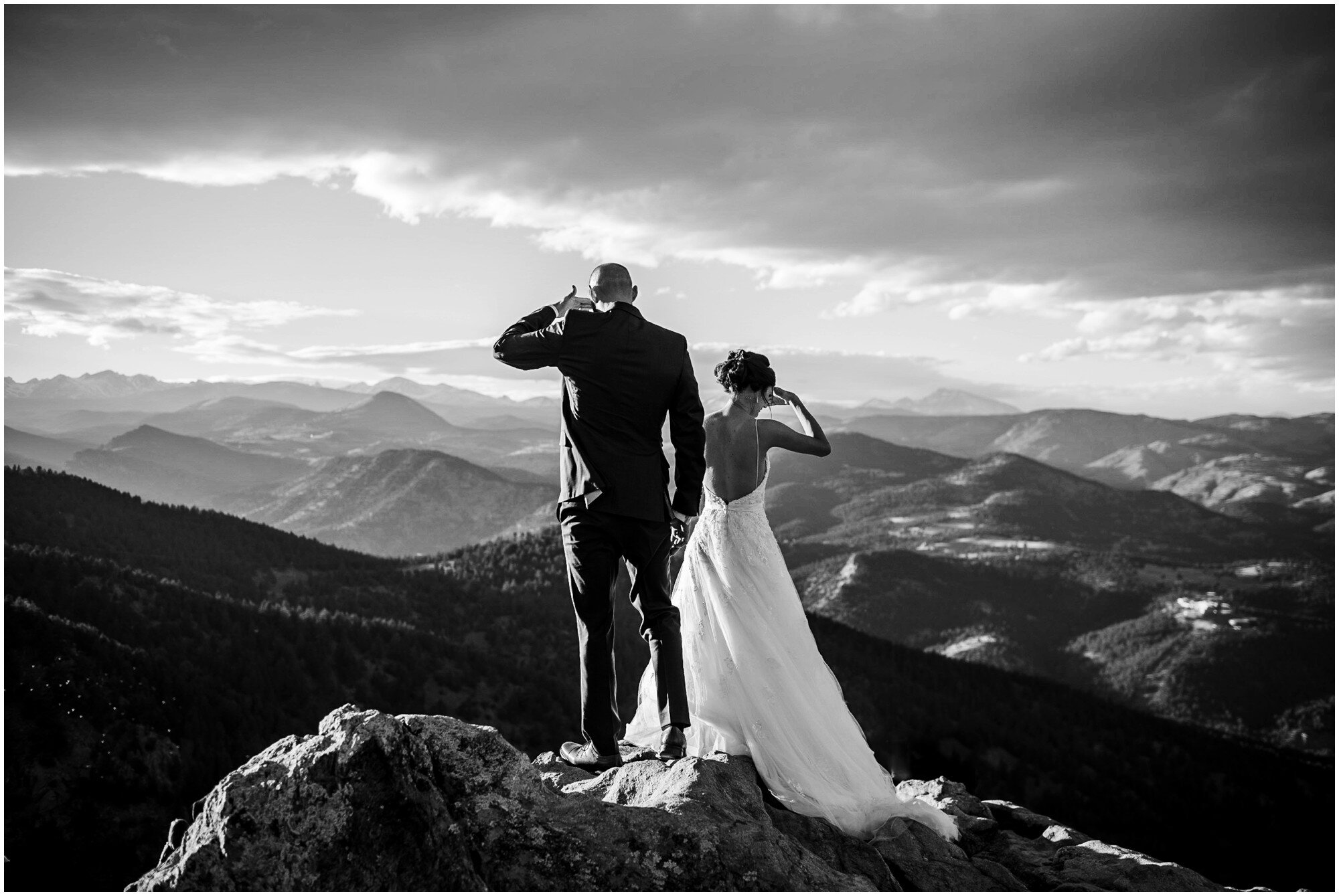 Bride and groom look out over Lost Gulch Overlook